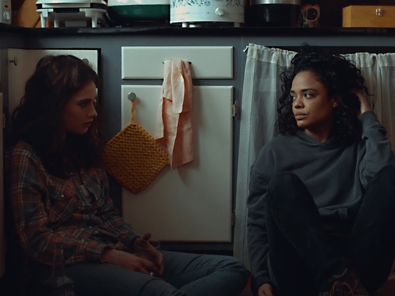 Lily James as Deb and Tessa Thompson as Ollie in LITTLE WOODS.