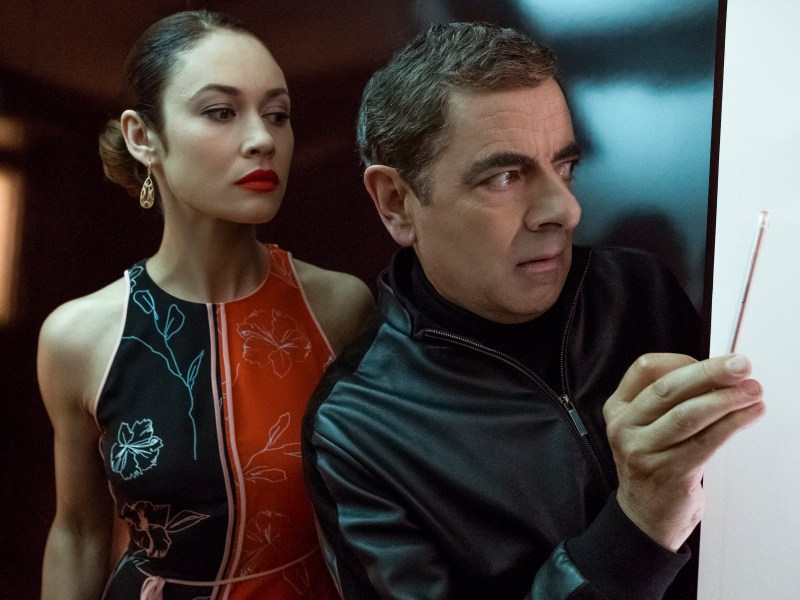 Olga Kurylenko as Ophelia and Rowan Atkinson as Johnny English star in JOHNNY ENGLISH STRIKES AGAIN, a Focus Features release.