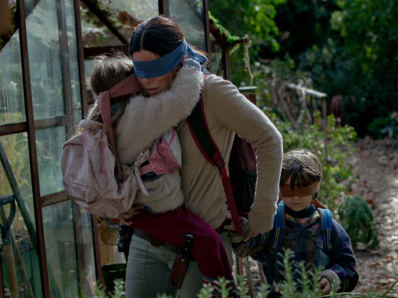 Vivien Lyra Blair, Sandra Bullock, and Julian Edwards in Bird Box