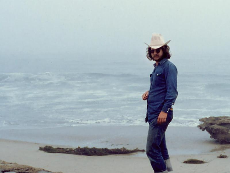 Jim Allison on the beach in a still from Breakthrough.