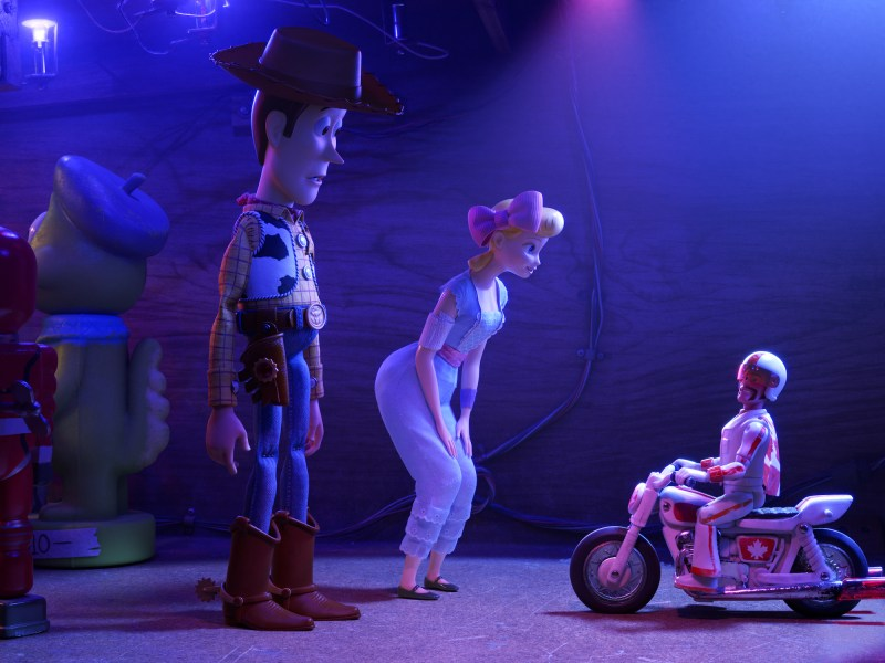 Woody (Tom Hanks), Bo (Annie Potts) and Duke Caboom (Keanu Reeves) in Disney-Pixar's Toy Story 4