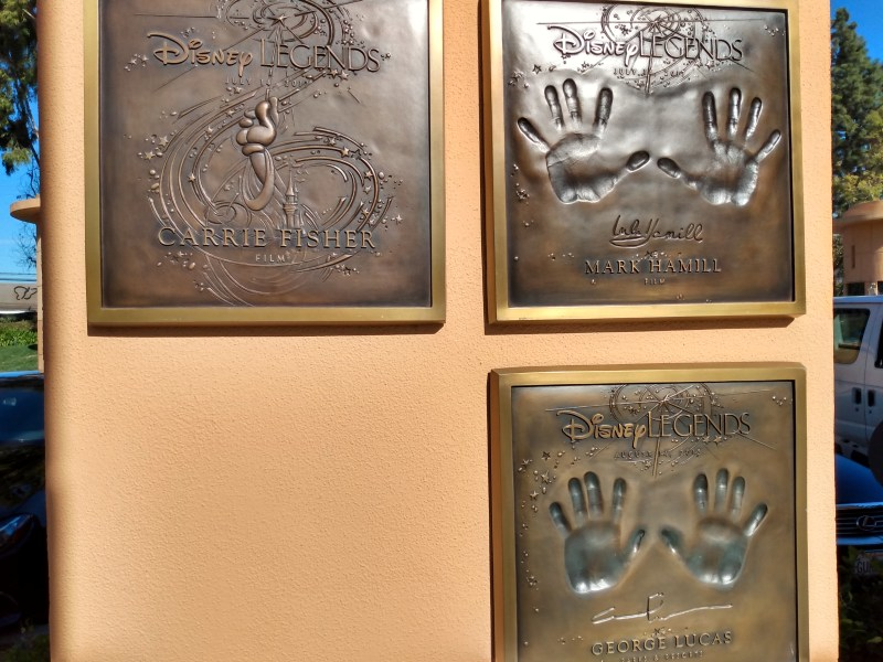 The Disney Legends plaques of Carrie Fisher, Mark Hamill, and George Lucas.