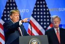 US President Donald Trump (L) and national security adviser John R. Bolton (R) Gints Ivuskans/Shutterstock