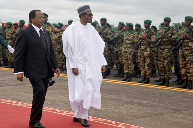 President of Cameroon Paul Biya (L) walks with Nigerian President Muhammadu Buhari (R) following his arrival at the airport in Yaoundé, Cameroon, on July 29, 2015. REINNIER KAZE/AFP/GETTY IMAGES