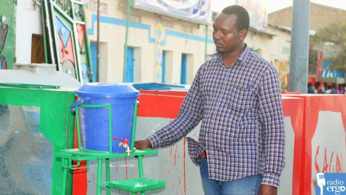 technician makes hand-washing station