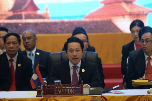Laos Foreign Minister Saleumxay Kommasith (C) delivers the opening speech at the planary session of the Association of Southeast Asian Nations' (ASEAN) 49th annual ministerial meeting in Vientiane, July 24, 2016.
