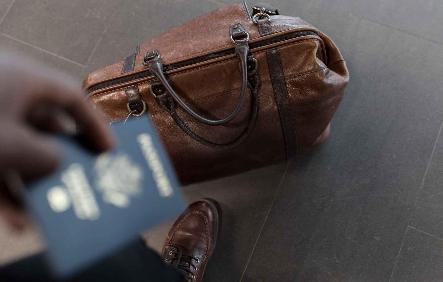 brown leather duffel bag