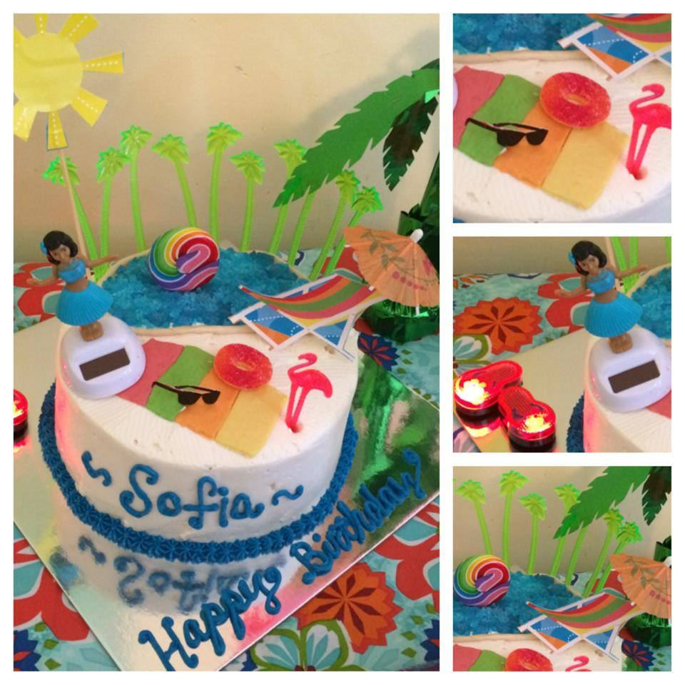 Pool and Luau Themed Cake, Rock Candy Water, Tootsie Roll Beach Towel, Peach Ring Float, Plastic and Paper Decor