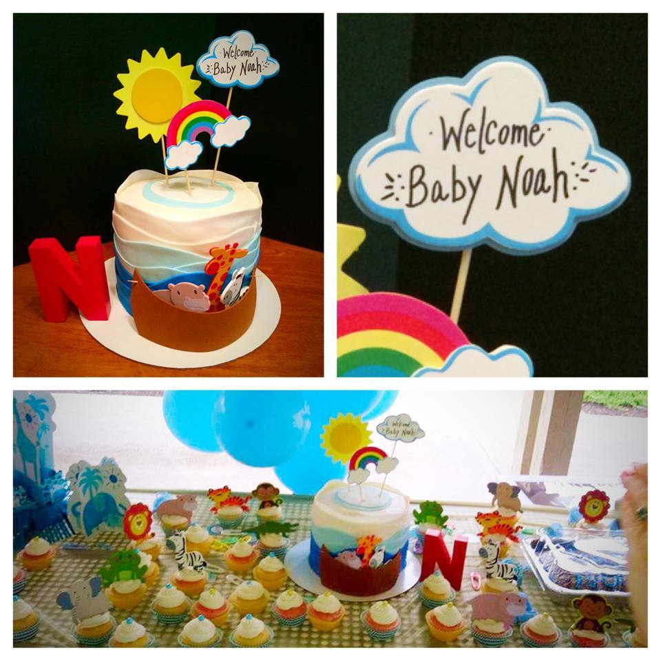 Noah's Ark Themed Baby Shower Cake with Fondant Wave Decor and Wood Craft Animals and Foam Boat