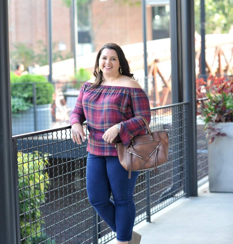 Emily Bastedo the blogger behind Something Gold, Something Blue style blog is featuring a plaid off the shoulder top from Anthropologie this fall with a vegan leather bag from Pinkstix.