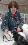 Dog getting treats on a boat