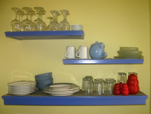 Daily dishes sit on a shelf.