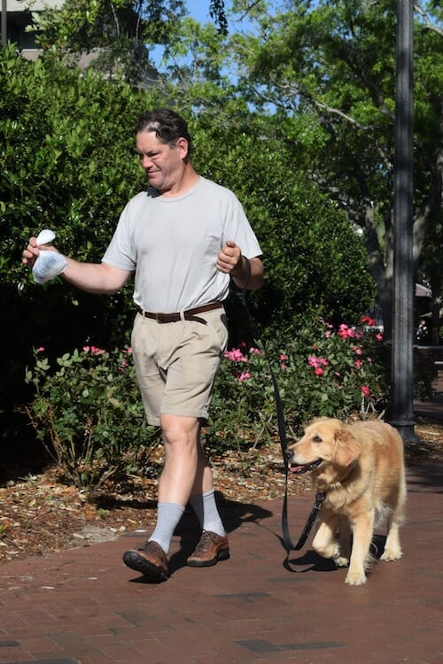 Mike walks Honey and wonders what to do after scooping the poop.