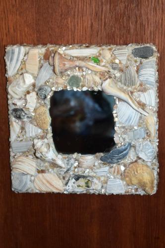 Mosaic sea shell mirror.