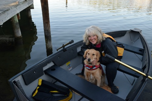 Honey the golden retriever and Pam in dinghy.