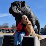Honey the golden retriever and Pam with the Citadel bulldog.