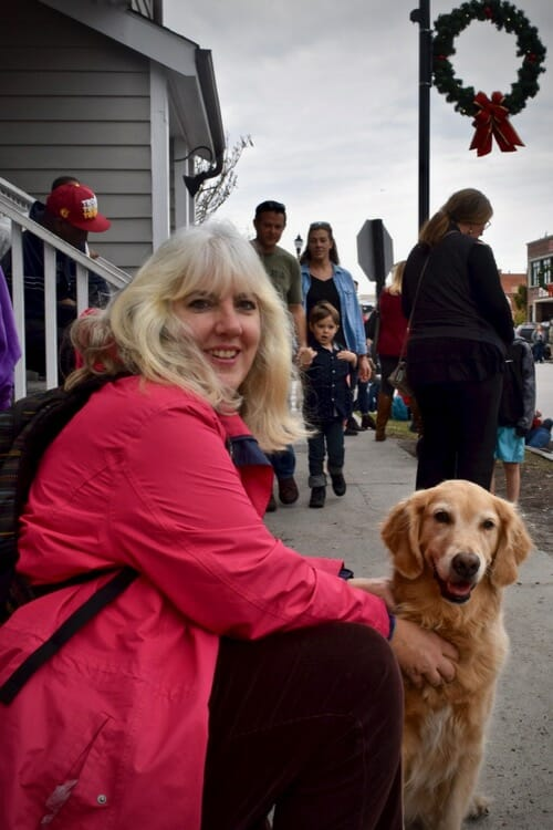 Learn about the wrong way to train your dog with treats.(Honey the golden retriever and Pam wait for the parade to begin.)
