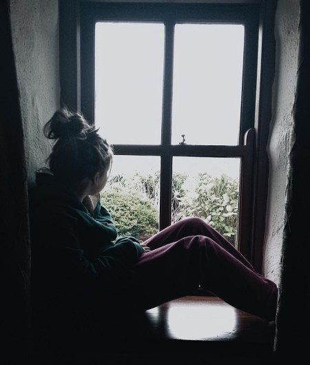 ALT=picture of girl by window