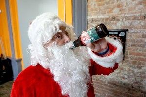 Santa drinking a beer