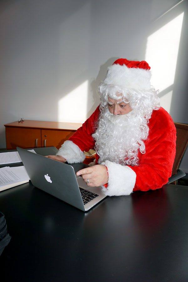 Santa sitting at Laptop