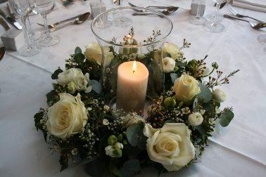 white rose ring of flowers around hurricane lamp