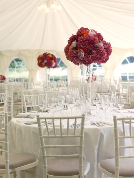 hot pink and orange tall table arrangements at Silchester