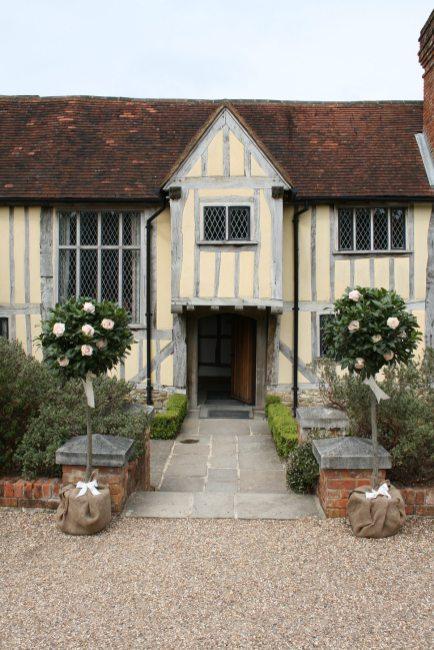 Entrance at Cain Manor bay trees