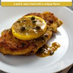 Chicken piccata topped with lemon on a round white plate with a fork and grey placemat (vertical with title and description overlay)