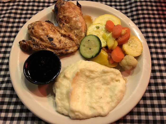 My Vacation in Food: Part 3: Teriyaki chicken with mashed potatoes and veggies on a round white plate