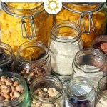 Assorted jars of dried foods on a concrete surface (with title overlay)