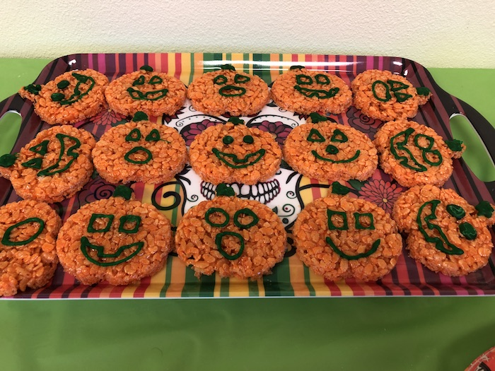 Pumpkin-Shaped Rice Krispies on a tray on a green table