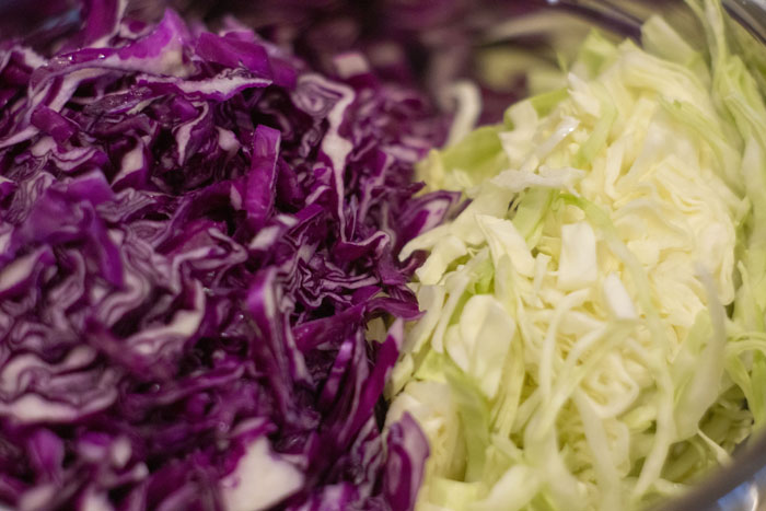Close up of thinly sliced purple and green cabbage