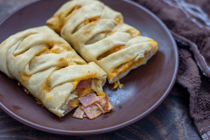 Ham and Cheese Hot Pocket on a brown plate