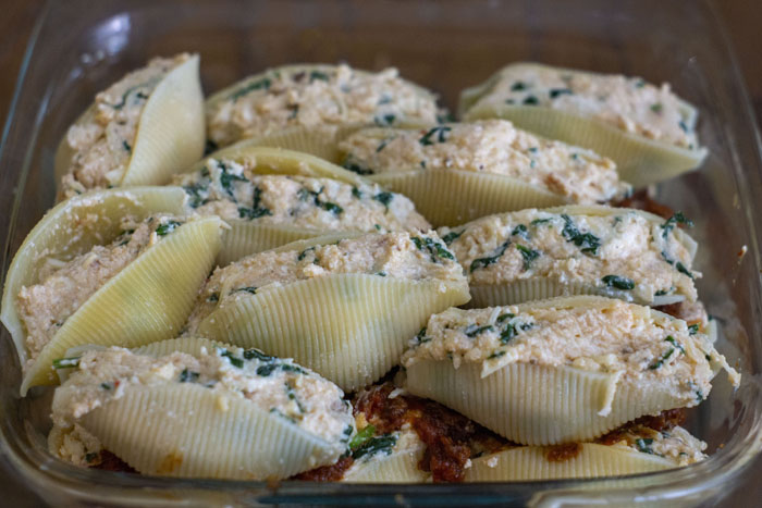 Glass baking dish with two layers of stuffed shells