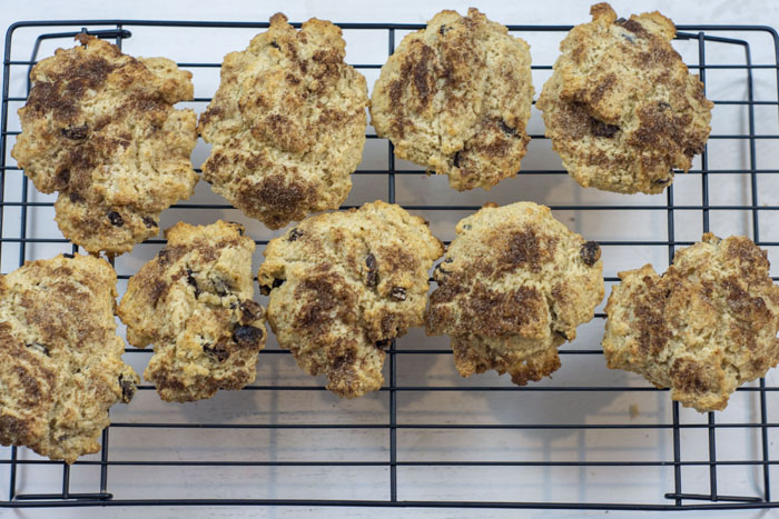 Rock cakes cooling on a wire rack on a white surface