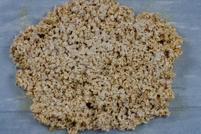 Pile of prepared rice krispies on a piece of parchment paper