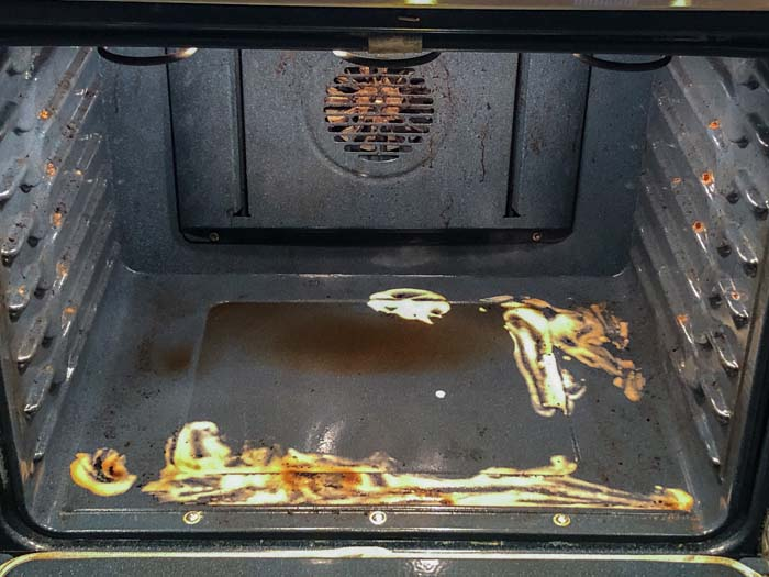 Dirty oven with baking soda and vinegar turning brown from cleaning the dirty spots