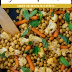 Chopped cauliflower, baby carrots, and chickpeas topped with mint leaves with a wooden spoon in a large nonstick skillet on a wooden surface (vertical with title and description overlay)