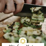Woman's hand using a chef's knife to chop a green vegetable on a bamboo cutting board (with title overlay)