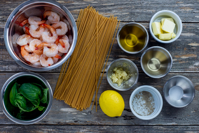 Ingredients for shrimp scampi on a wooden surface