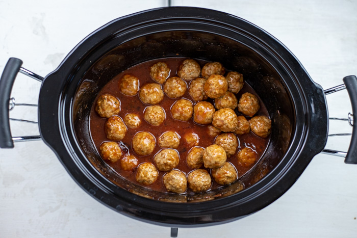 Swedish Meatballs in the slow cooker on a white surface