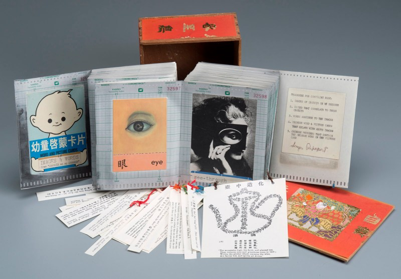 """Objects On My Dresser, Phase 9: Chinese Word/Picture Cards"", artist book: Chinese word/picture cards, laminate, yarn, Chinese proverbs, and business computer forms, 1982."