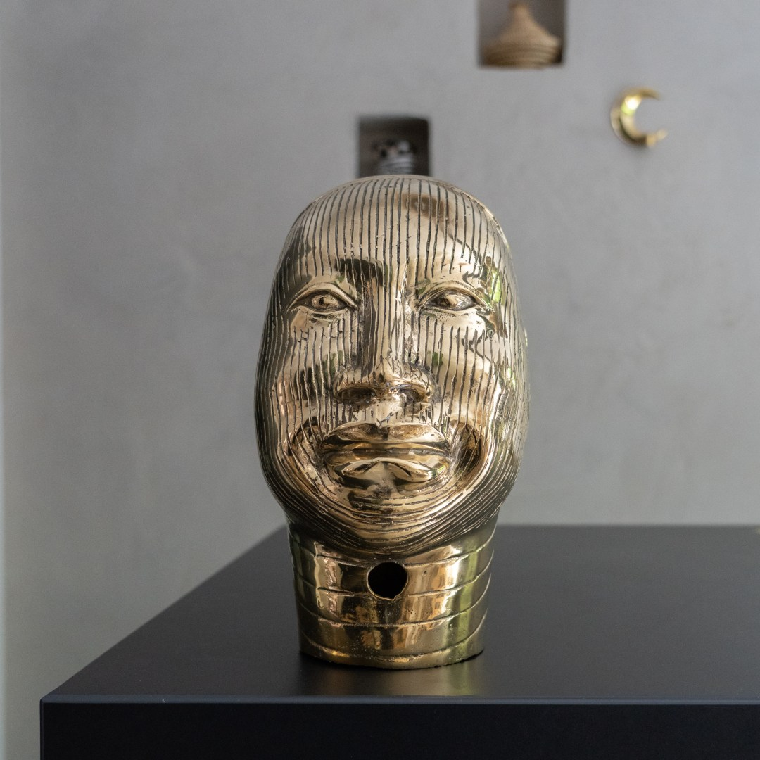 african oni queen in polished bronze