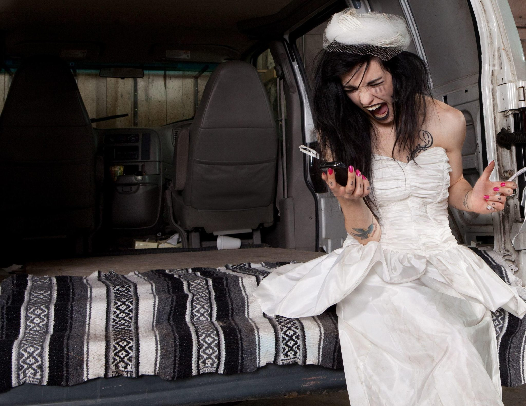 11700151 – stood up angry bride screaming at her phone