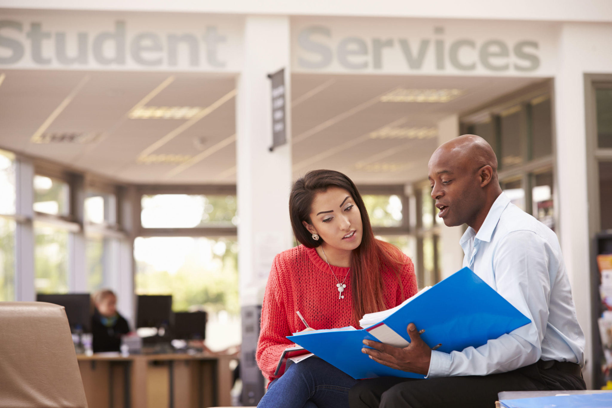 42311825 – college student having meeting with tutor to discuss work