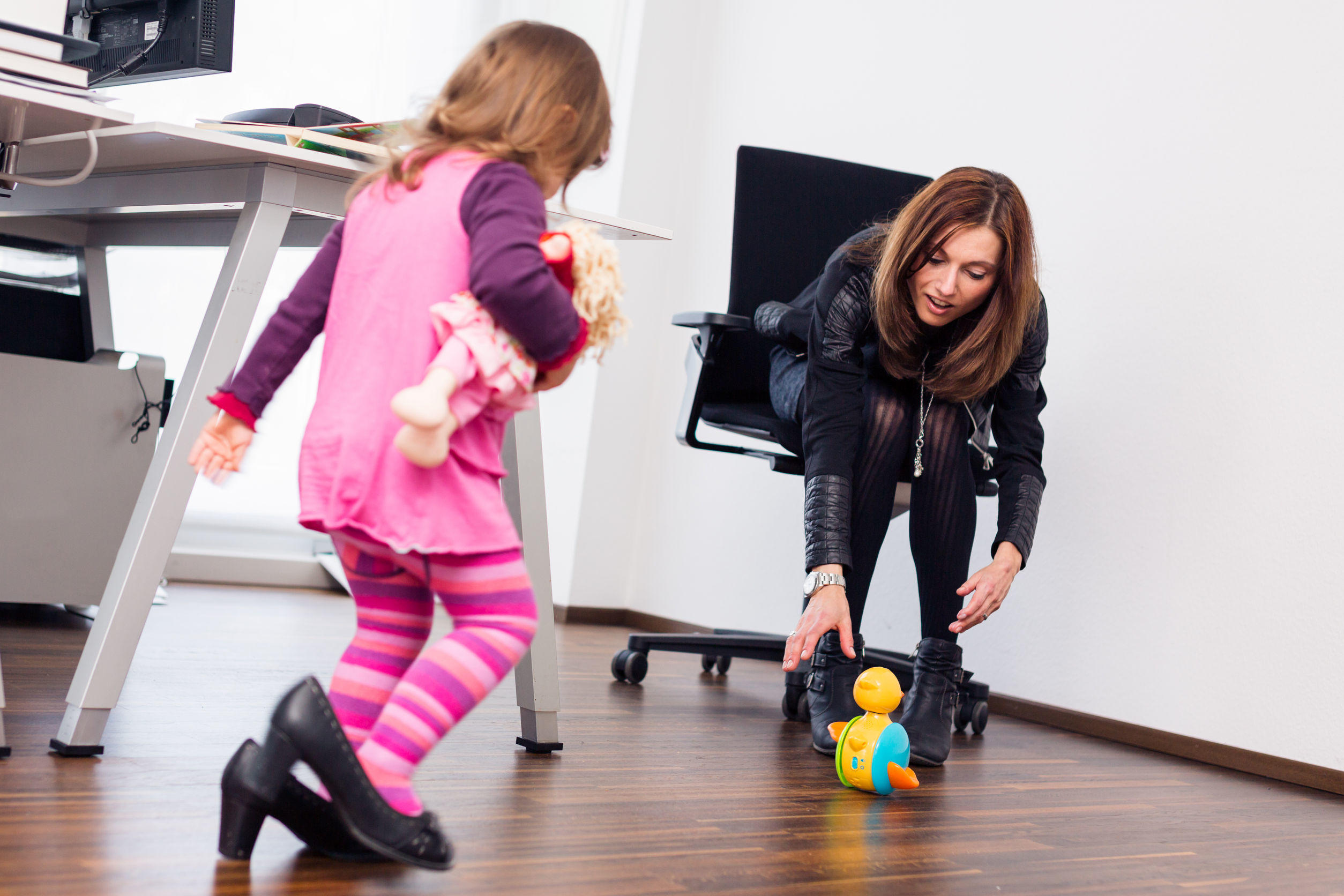 70368793 – working mom and daughter at the office