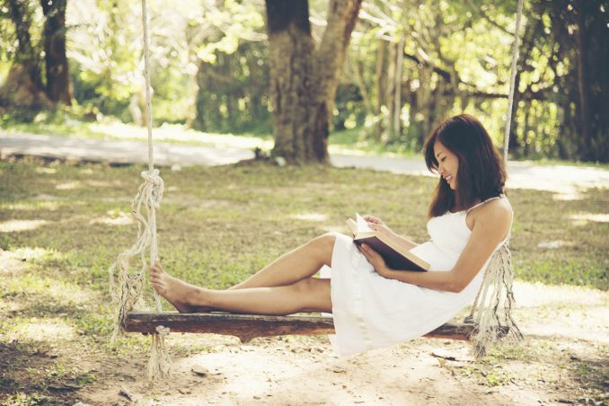 97588033 – relaxation woman reading a book in the park