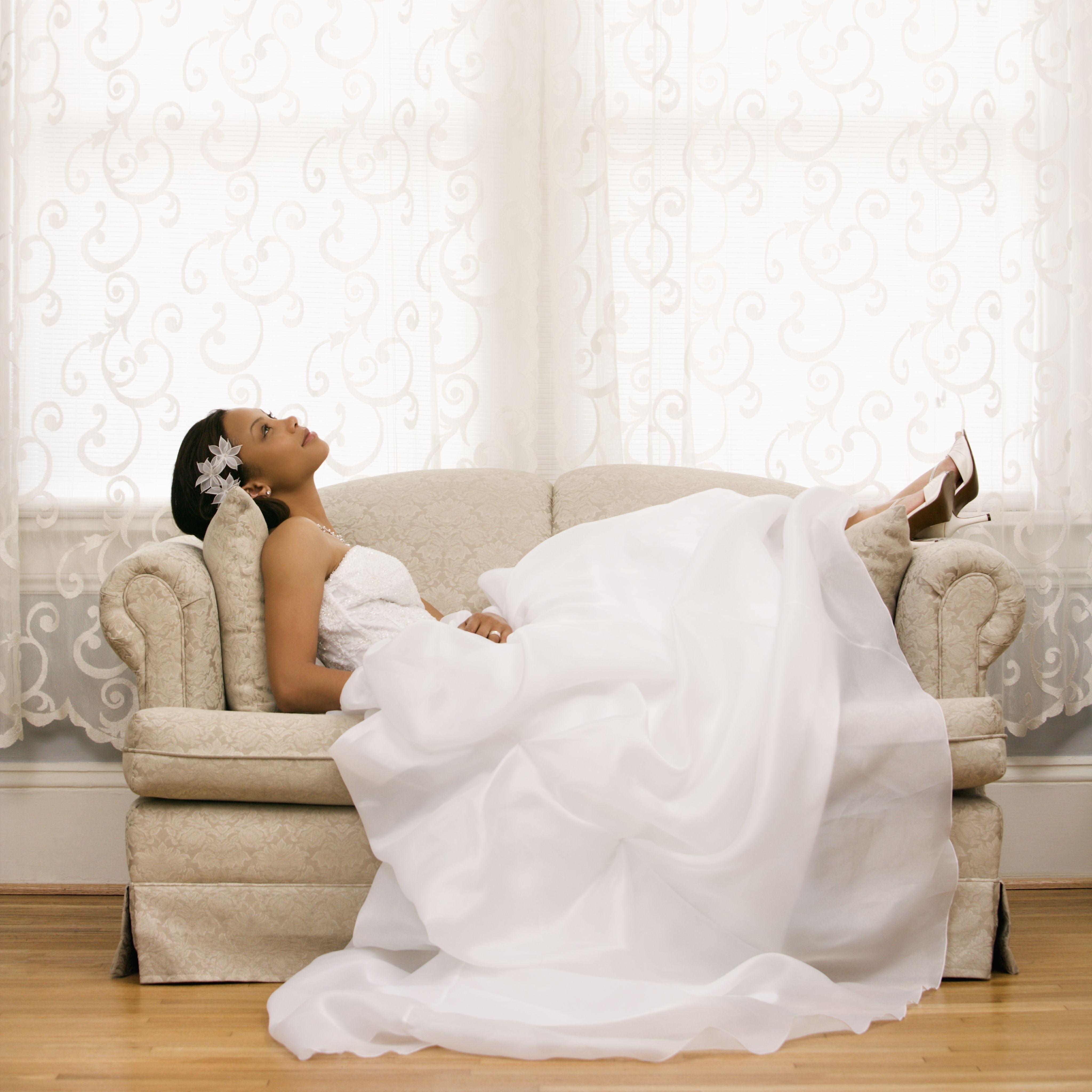 2145622 – african-american bride lying on love seat.