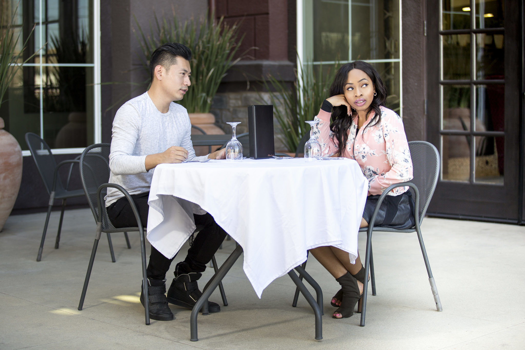 Couple Fighting in an Outdoor Cafe Date