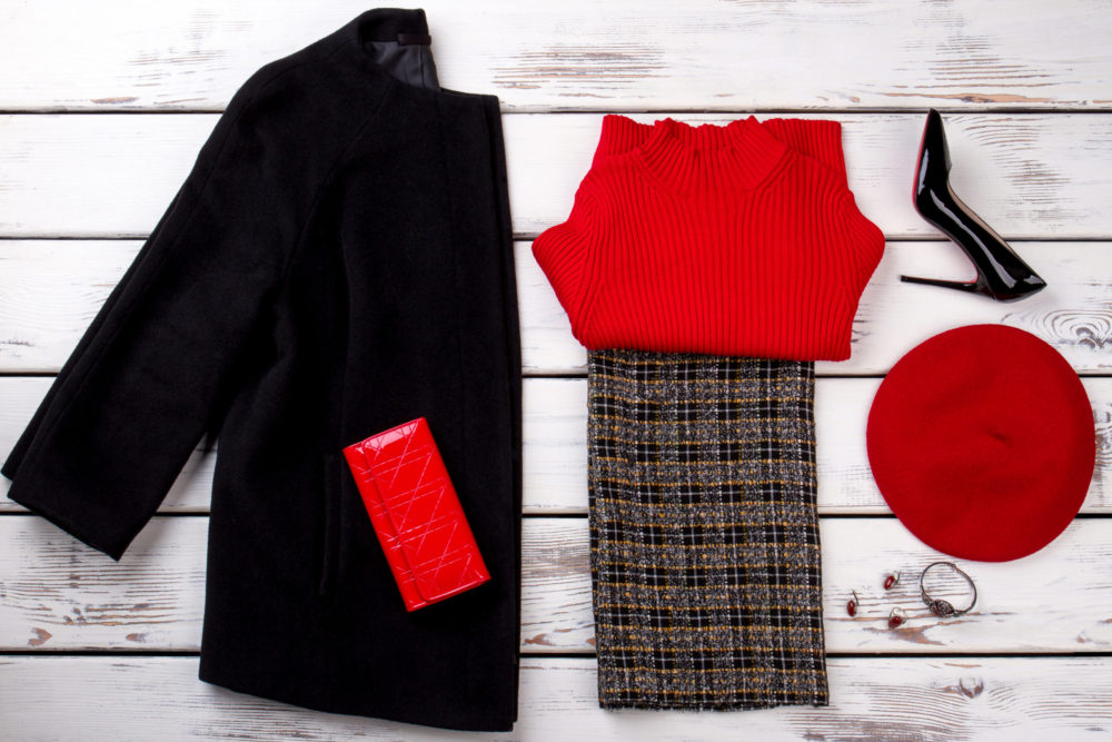 Winter women's outfit with hat, wallet and accessories.